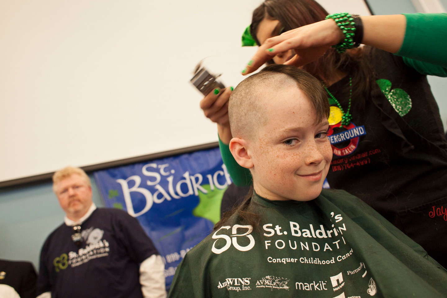 J.T. Travers, 9, from the Wilson School, had his head shaved.
