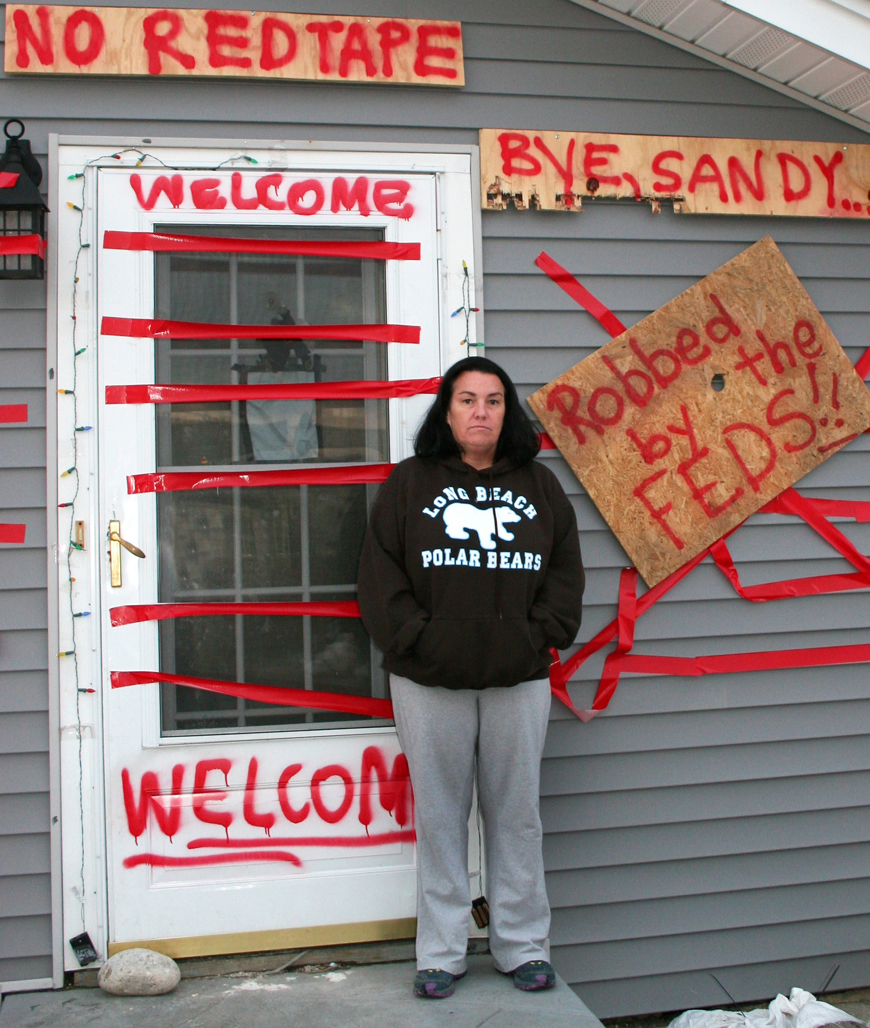 Sam Kinsley said she is waiting for money to rebuild her home, after building inspectors told her that 77 percent of the house was damaged.