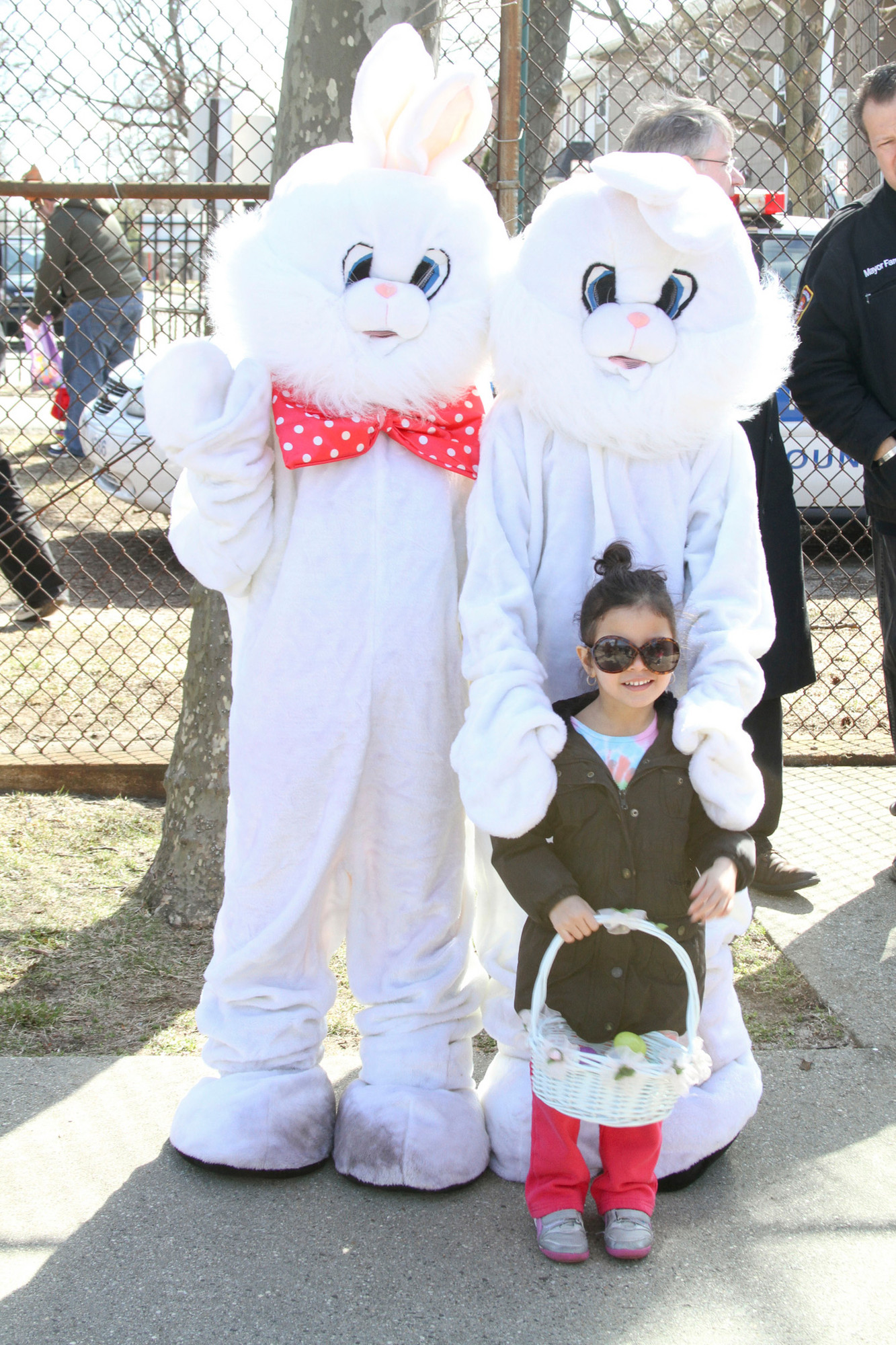 Liliana Ortiz, 4, with Mr. and Mrs. Easter Bunny played by volunteers from the Valley Stream Youth Council.