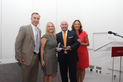 Robert LaCosta, left, Coach Realtors; Bonnie Stone-Sellers, CEO of Christie's International Real Estate; LP Finn, Coach Realtors; and Kathleen Coumou, SVP of Christie's International Real Estate.