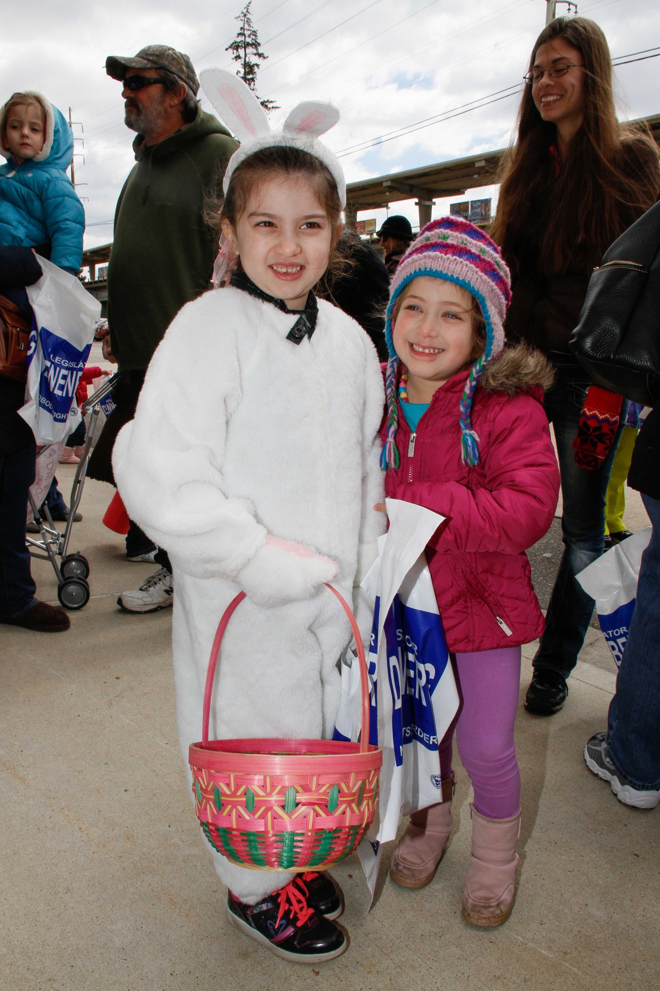 Eliana Conrad, 5, left, and Erica Shatz, 7, embraced the sprit of the holiday in spite of the cold.