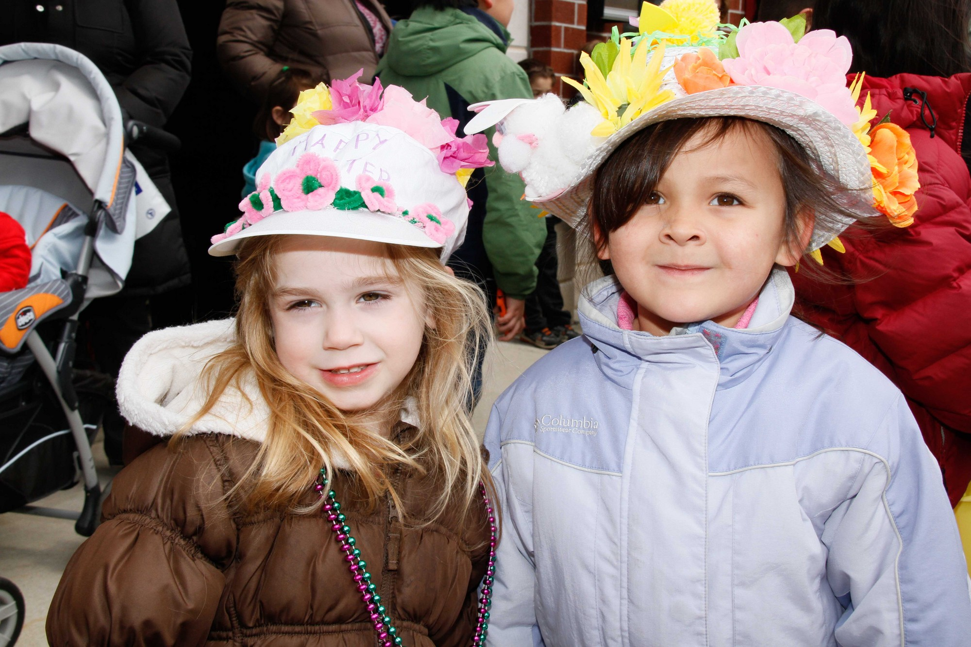 Abigail McGlone, 3, left, and Grace Ham, 5, wore their Easter bonnets for the parade.