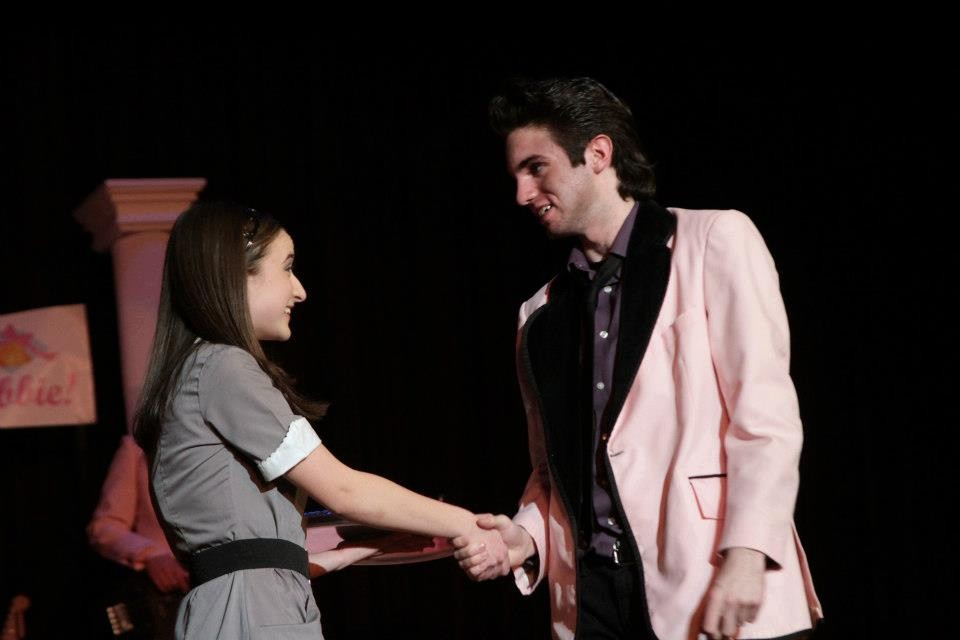 "Casey Getzler, left, played ""wedding singer"" Robbie Hart, who met waitress Julia Sullivan (Sabrina Garone)."