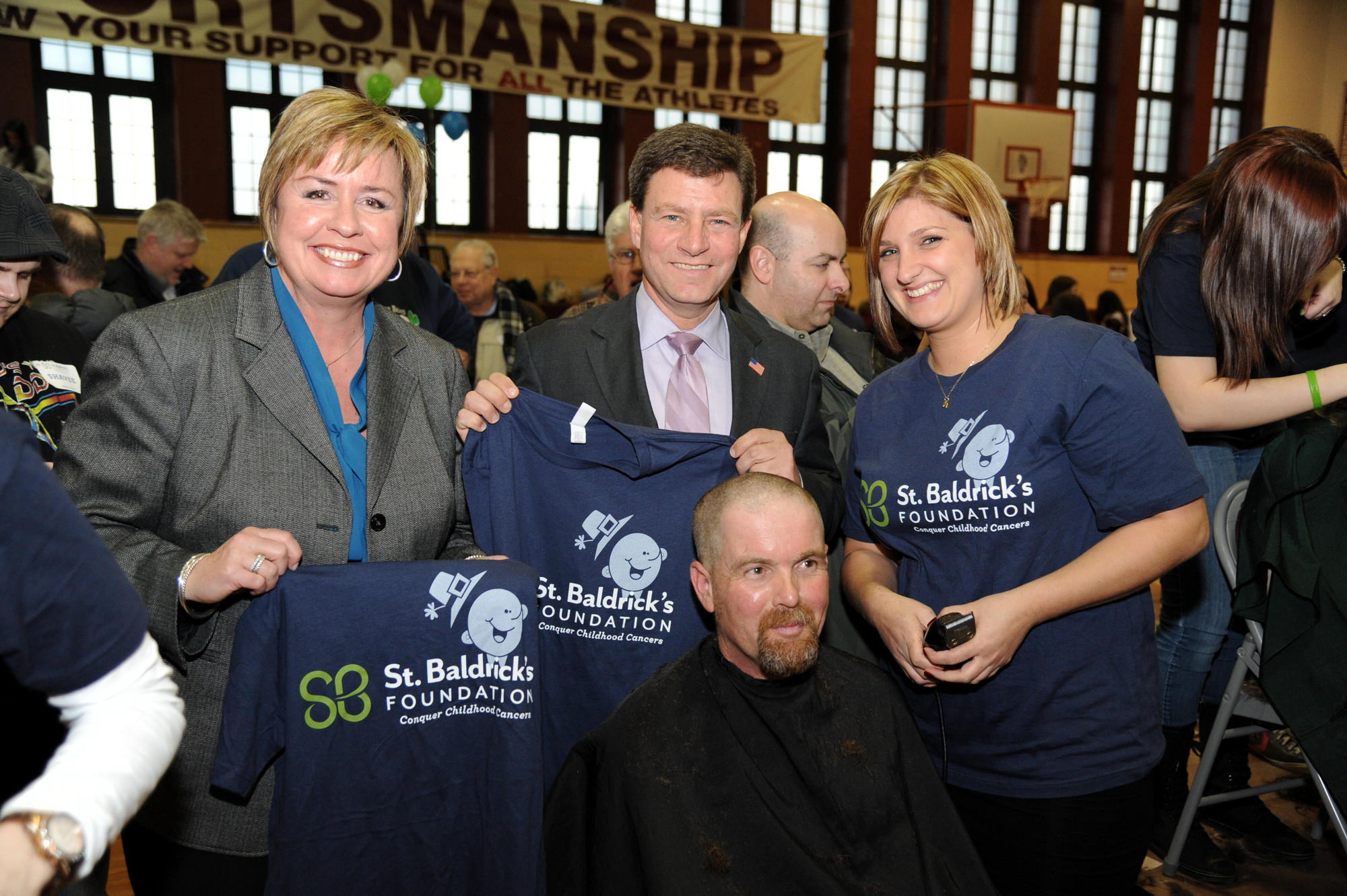 Town of Hempstead Supervisor Kate Murray and Nassau County Legislator Dave Denenberg looked on while Christin Castellvi shaved Steven Maher's head