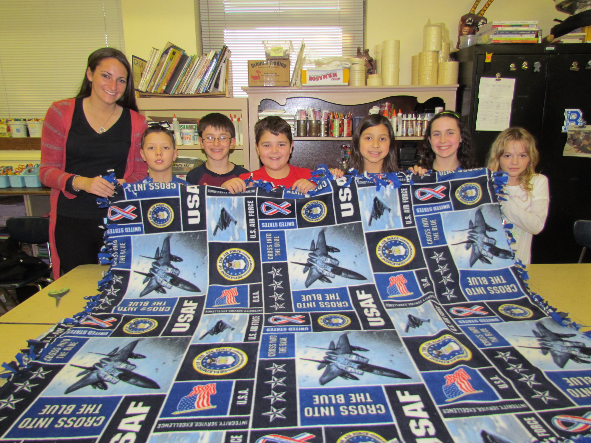 Jillian Leibowitz, left, whose mother, Jody, is a fourth-grade teacher at Winthrop Avenue Elementary School in Bellmore, helped Evan Collins, Andrew DiFusco, Ryan Kender, Emma Tiongson, Jessica Nachamie and Anna Bolles, from left, and other students make blankets for soldiers.