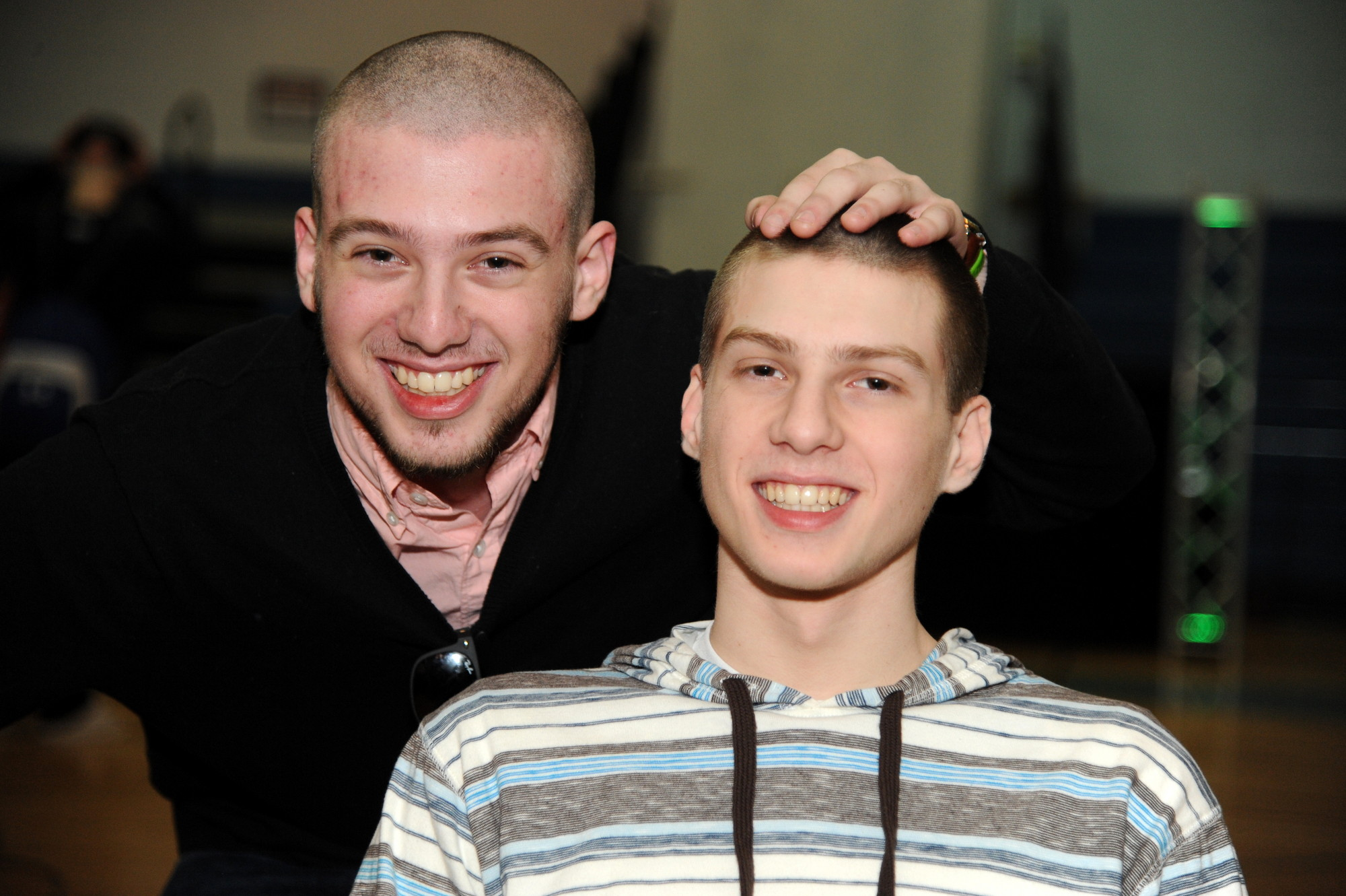 Alec and Dean Brownworth shaved their heads in solidarity with children with cancer, which Dean recently beat.