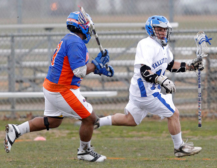 Valley Stream's Victor Huezo, right, carries the ball during the team's victory over Malverne/East Rockaway on March 28.
