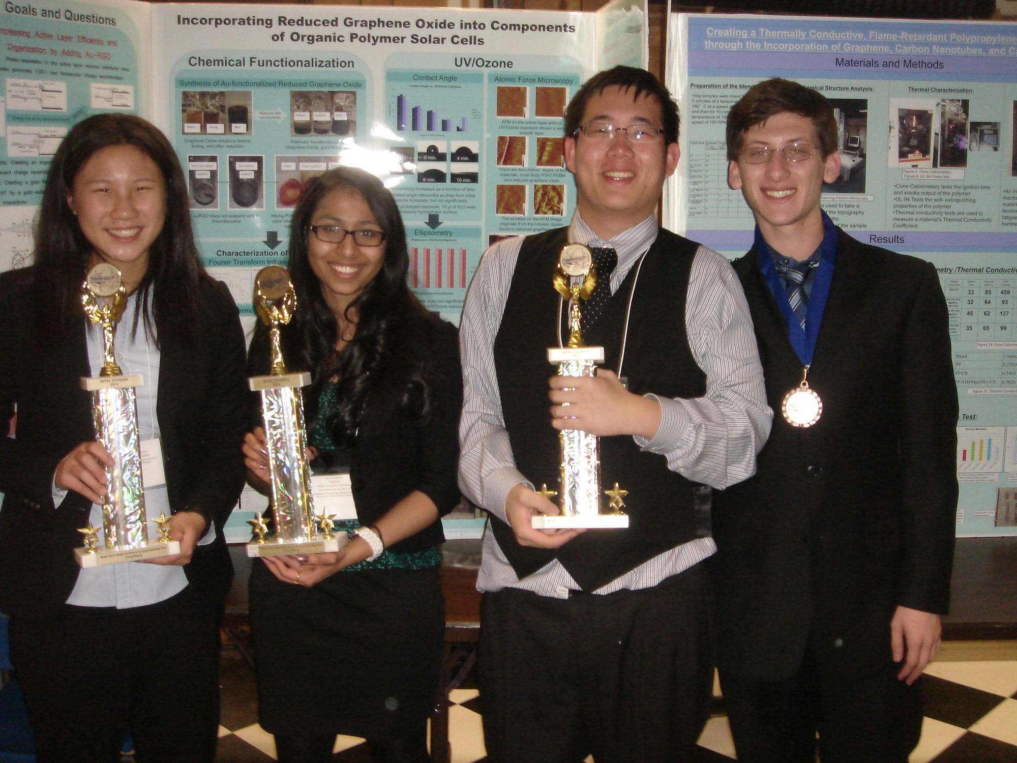 Lawrence High School students overcame the adversity of being relocated to the middle school to be named finalists in two science competitions. From left, Alexandra Tse, Sneha Chittathinini, Andrew Chen and Steven Krim won awards.