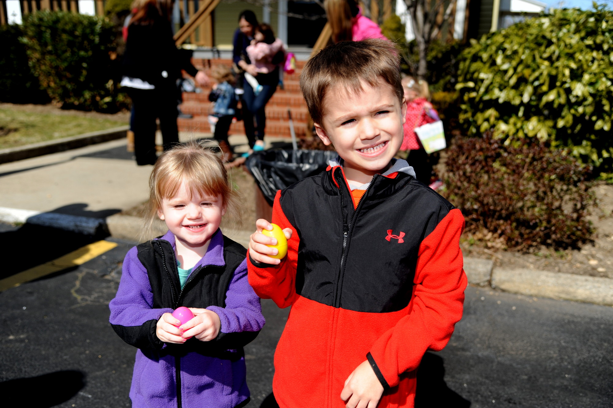 Riley Lahey, 2, and her brother Ethan, 4, show off their eggs.