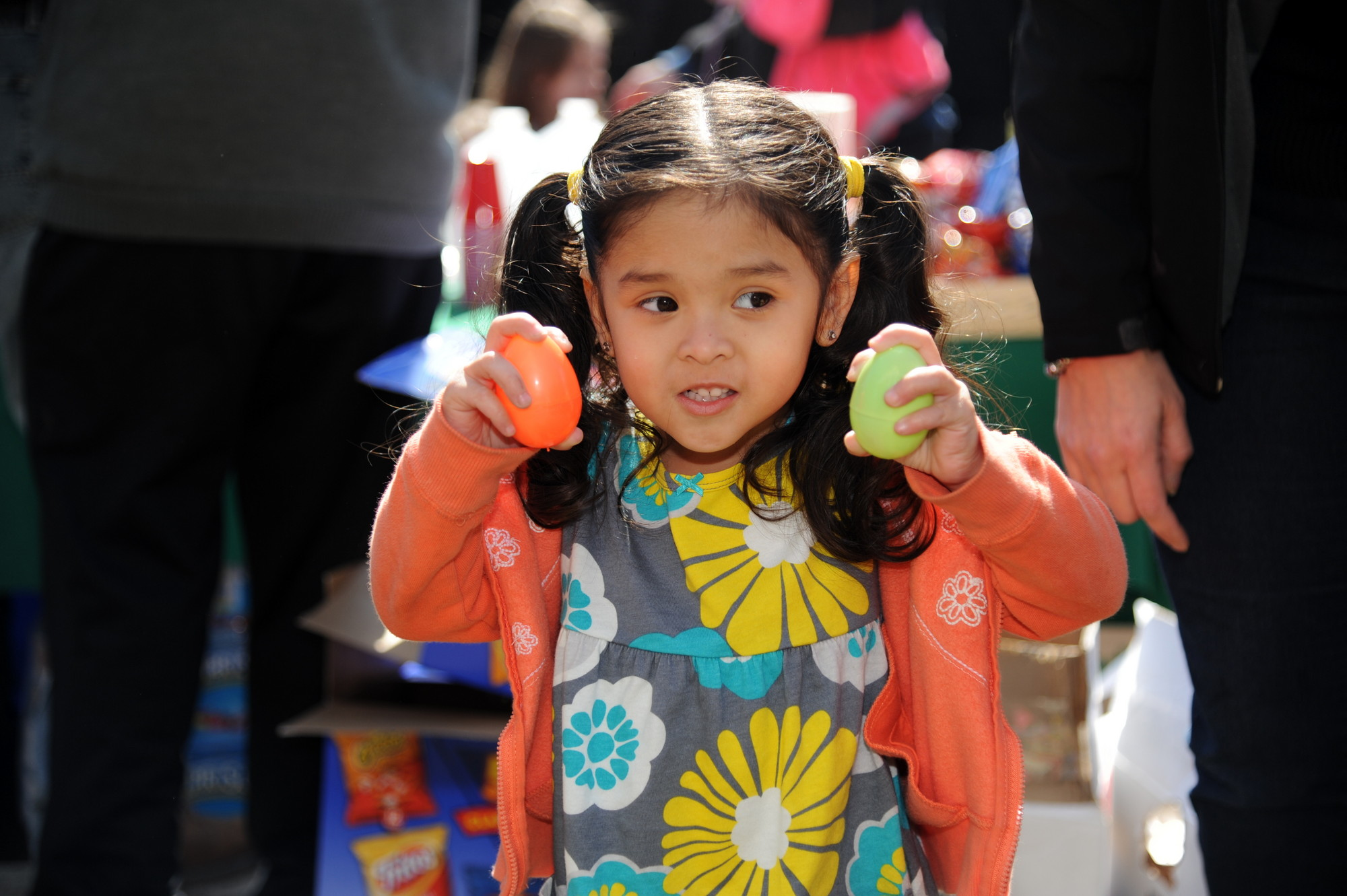 Siena Lopez, 3, holds two eggs she found at St. Joseph's Easter egg hunt in Hewlett on March 30.