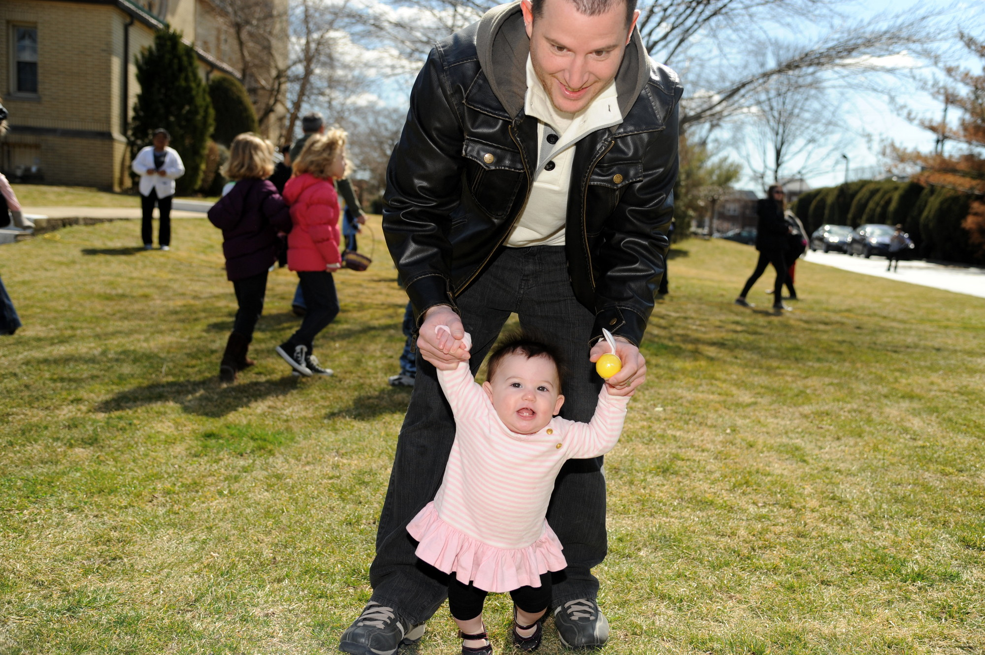 Donald McManamon helped his daughter Lana, eight months, in the egg race.