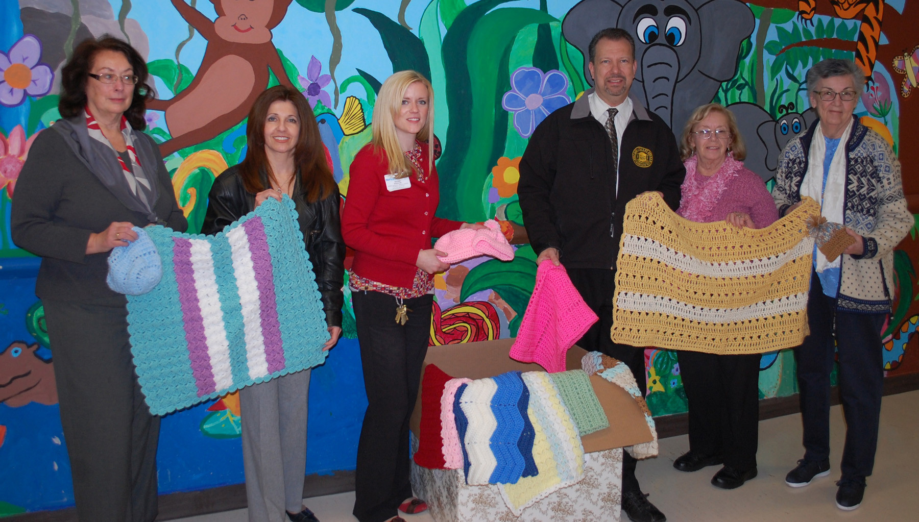 Members of the Silver Threads senior group and Valley Stream village officials visited Nassau University Medical Center last week to deliver handmade blankets and hats. From left are Monica Kerner, SallyAnn Esposito, Heather Spanfelner, Mayor Ed Fare, Barbara Welter and Joan Manney.
