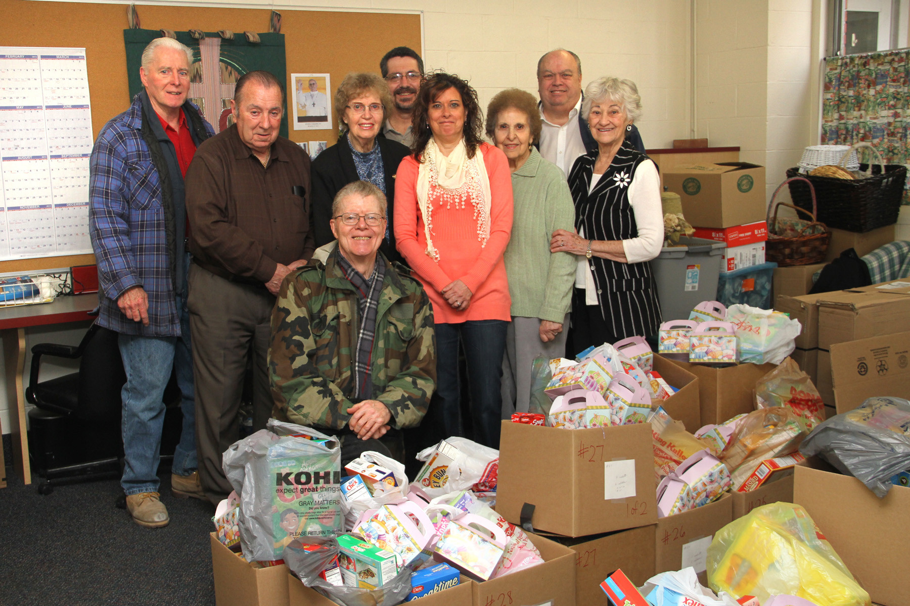 Blessed Sacrament Parish Outreach Center director Judy Miccio, fourth from right, is joined by volunteers Dave McKean, Charles McLaughlin, James Cunningham, Nancy Farrington, Mark Daley, Mary Gluck, James Riley and Angelina Bonfiglio who put baskets together for needy families in Valley Stream.