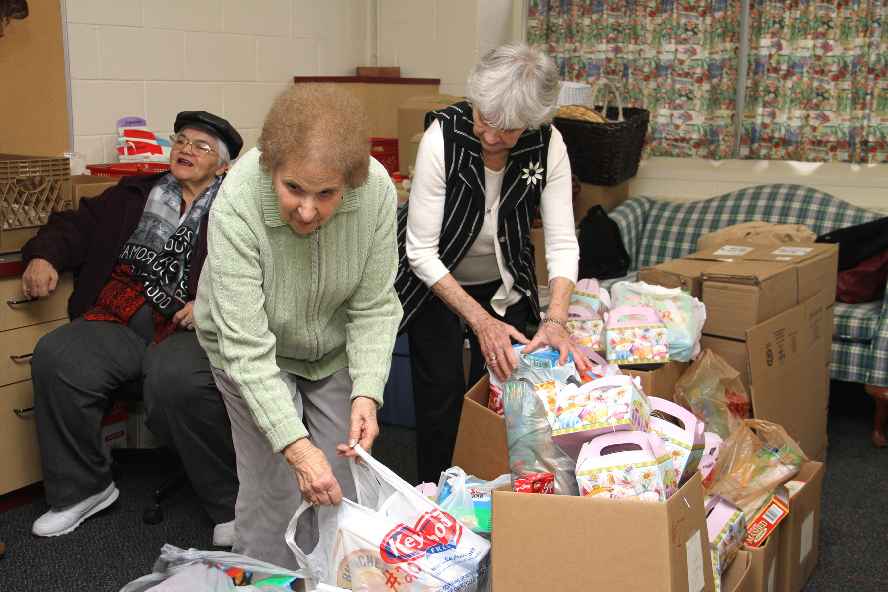 Parishioners Mary Gluck and Angelina Bonfiglio sorted through the boxes of food.