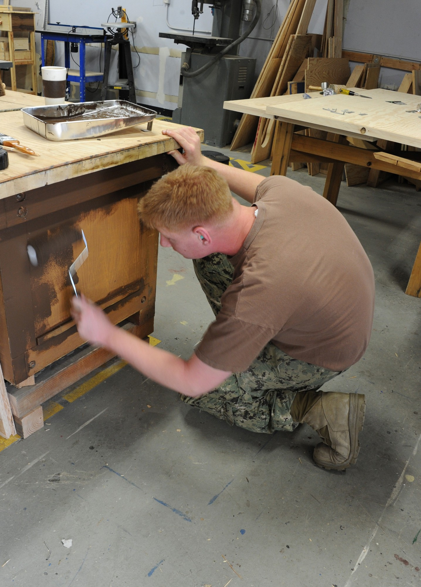 Builder 3rd Class John Skoblicki, of East Rockaway, painted a work bench inside the Naval Air Facility Atsugi Public Works workshop in Japan.