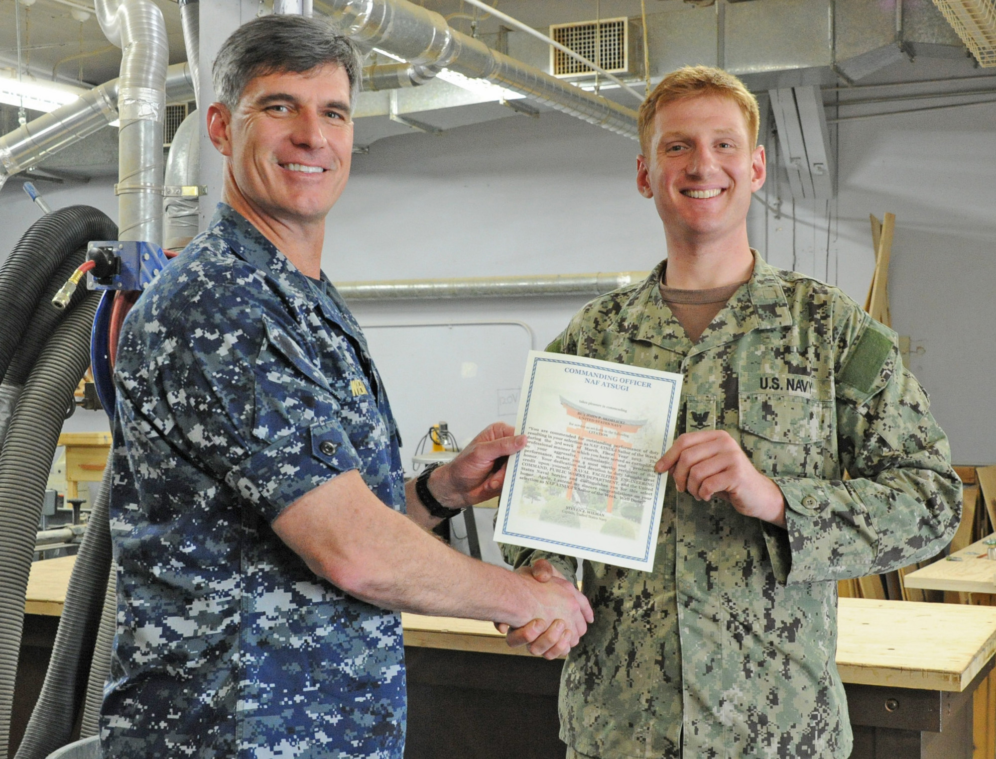 Skoblicki, right, received a letter of commendation from Naval Air Facility Atsugi Commanding Officer Capt. Steven Wieman in recognition of his selection as Sailor of the Week.