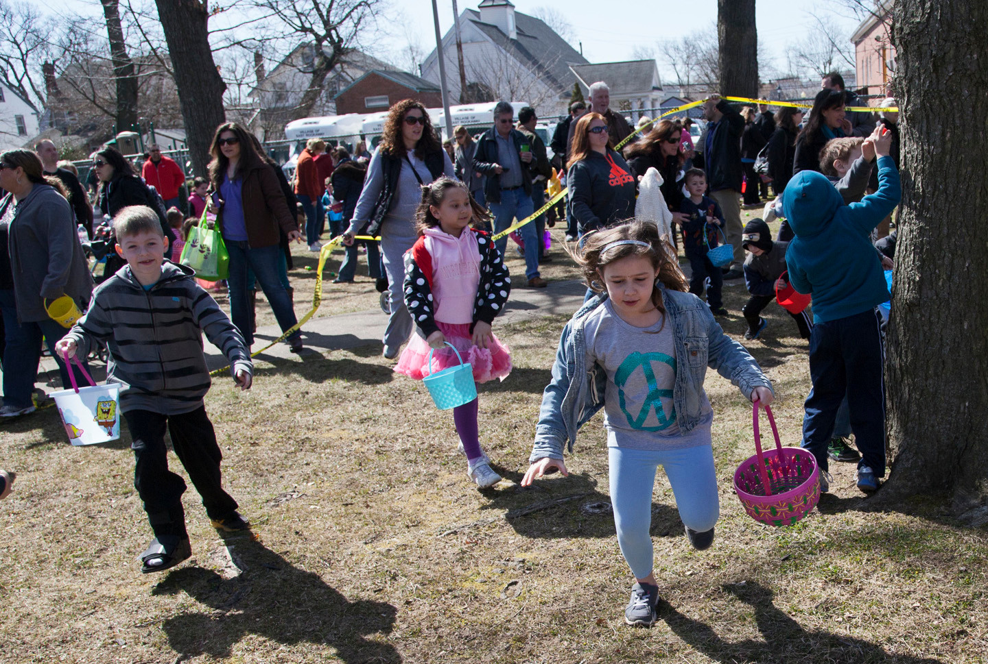 And they�re off! Children raced to pick up the colorful, scattered eggs.