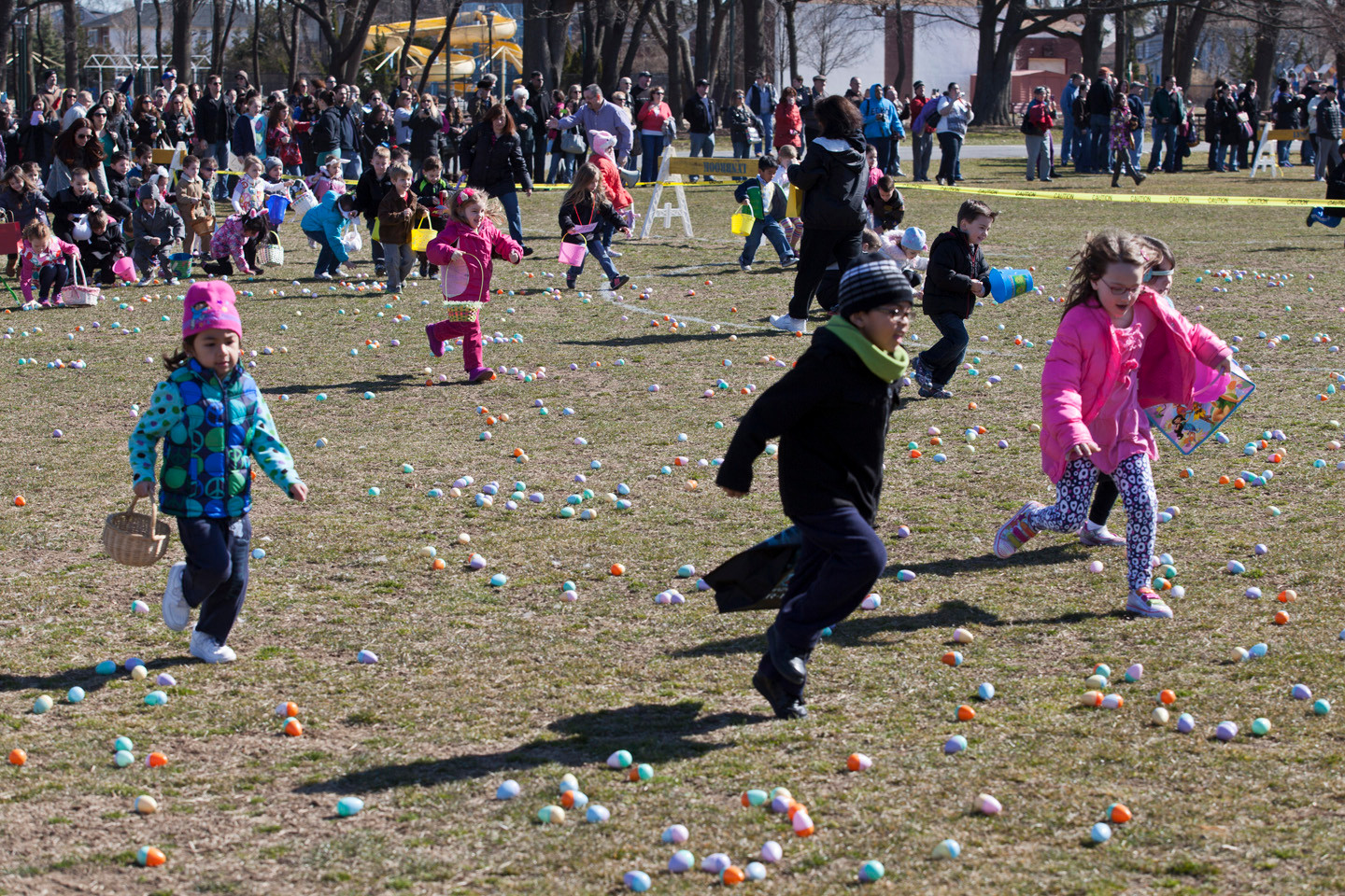 Children raced to collect the most eggs in Greis Park.