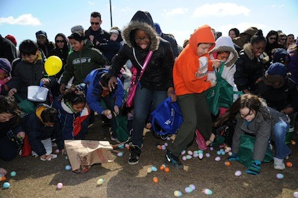 Children scrambled to gather as many eggs as possible on the Newbridge Road Park lawn during the Town of Hempstead's annual 'Eggstravaganza' last Saturday.