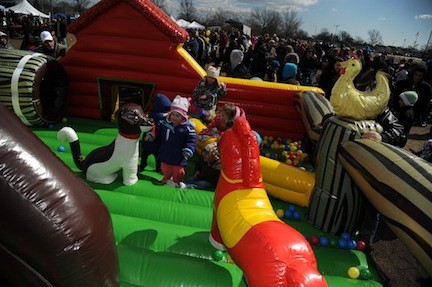 Children bounced around in the inflatable funhouses at the event.