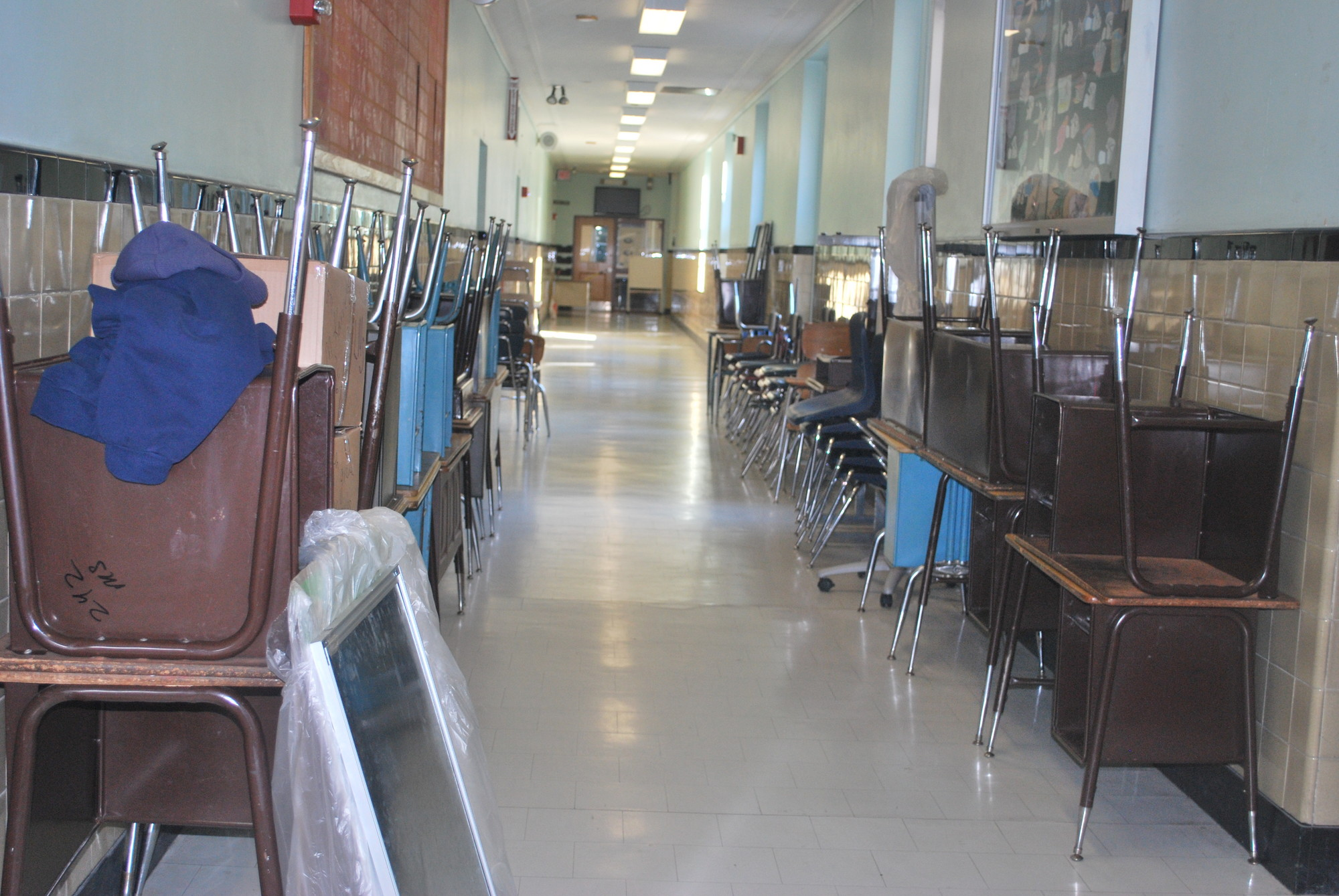 Desks and chairs lined a 