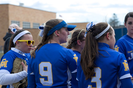 Sandra Foster, with her cochlear implant attached to her right ear, huddled with her East Meadow teammates during a recent game against Hicksville.