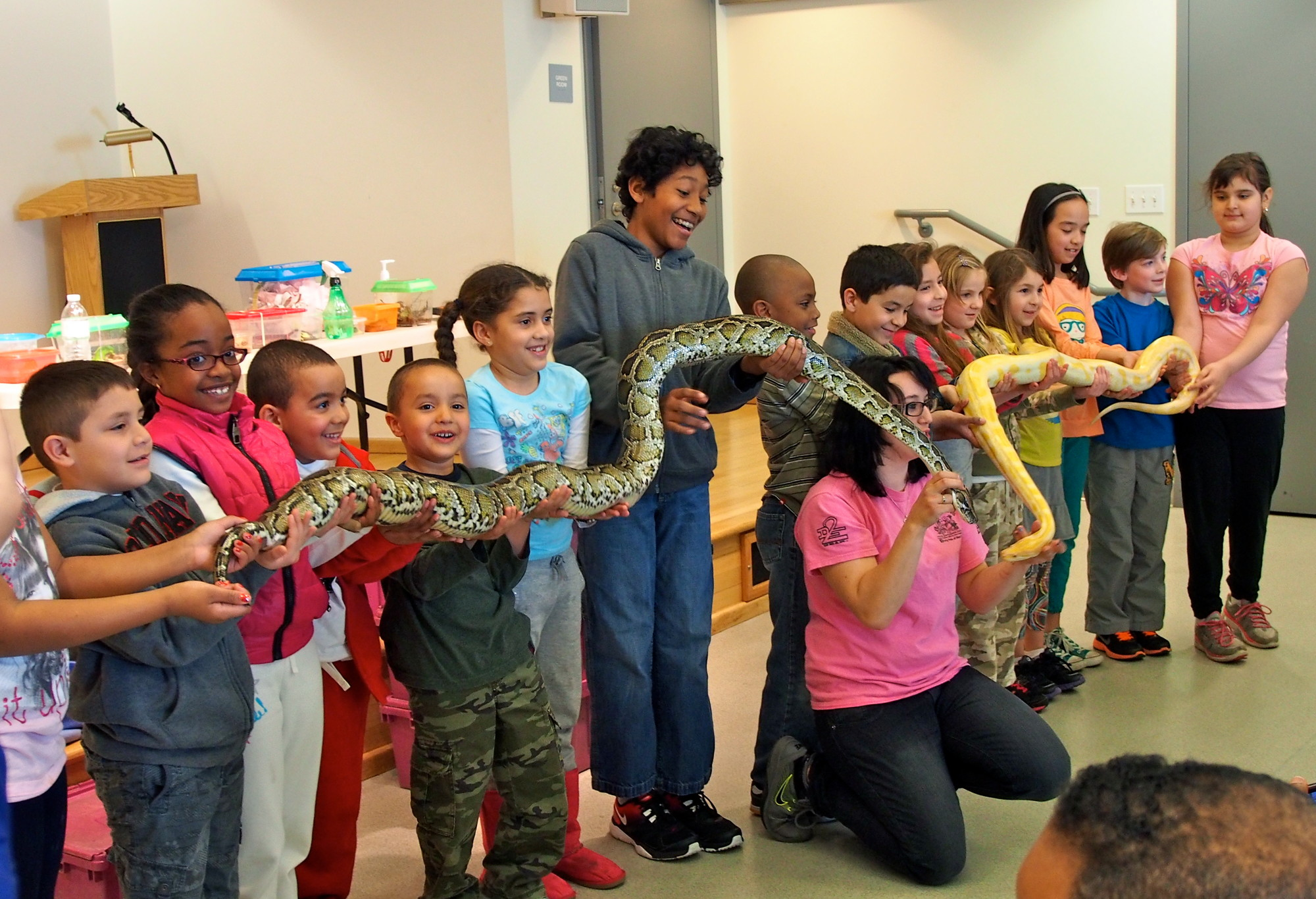 More than 100 kids and parents attended a Party Pets exhibition at the Baldwin library recently. Here, Jake and Banana, a pair of Burmese pythons, made a bunch of new friends.