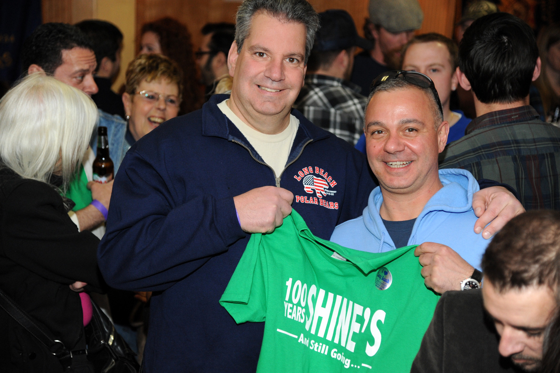 Bill Holtmeyer and Paul Montasano showed their love for Shine's with a signature T-shirt.