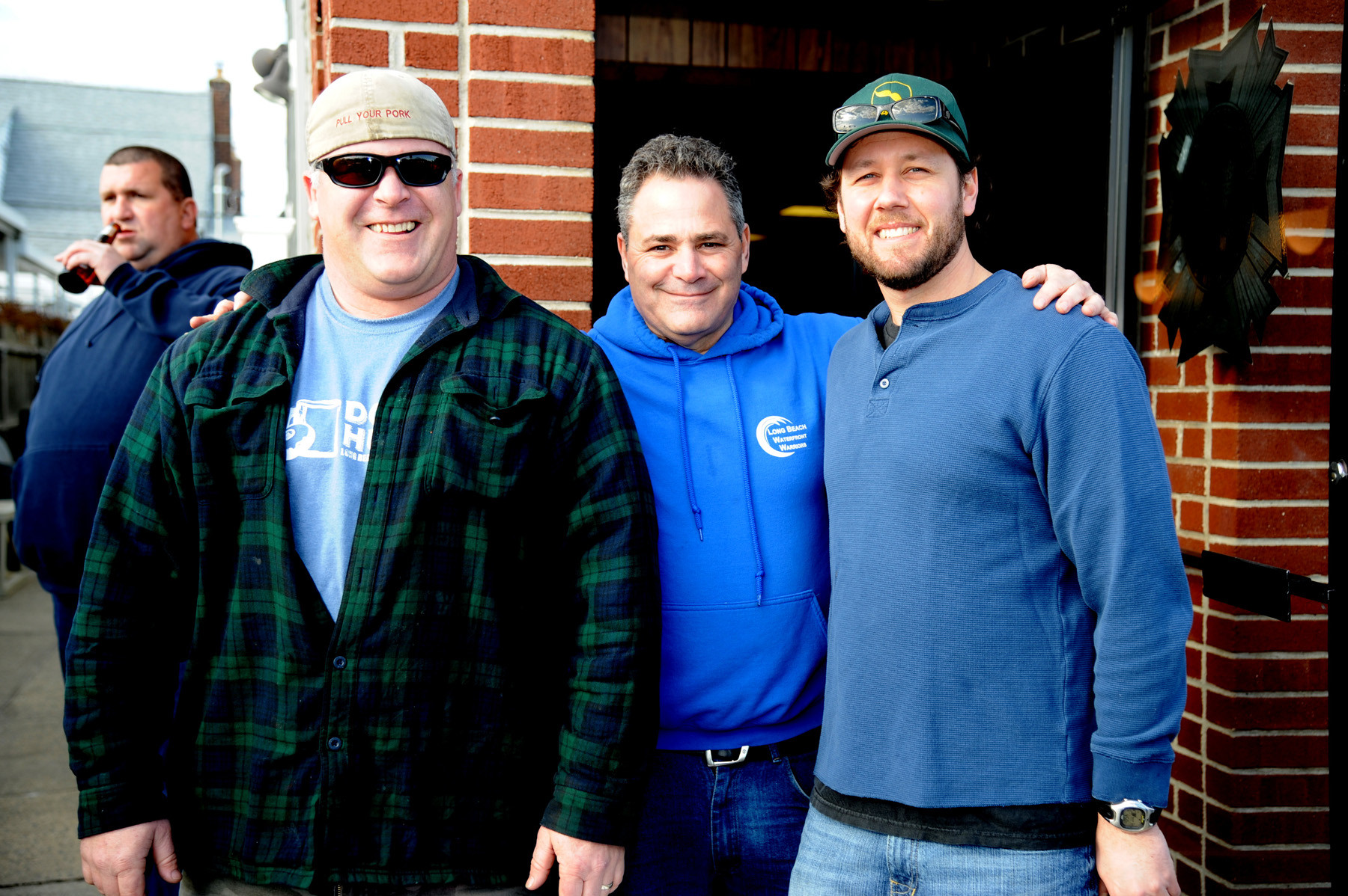 Event organizers Sean Sullivan, left, and Billy Kupferman, far right, were joined by local radio host Howie Appel, and said that they were thrilled with the fundraiser's turnout.