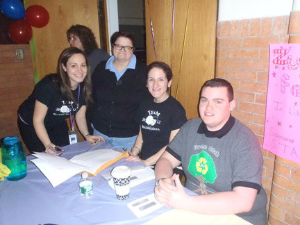 STAC Advisor Toni Cesare, left, former Advisor Debbie Bolton, Advisor Theresa Giuletti and STAC President Michael Gregori were at the sign-up table for the event.