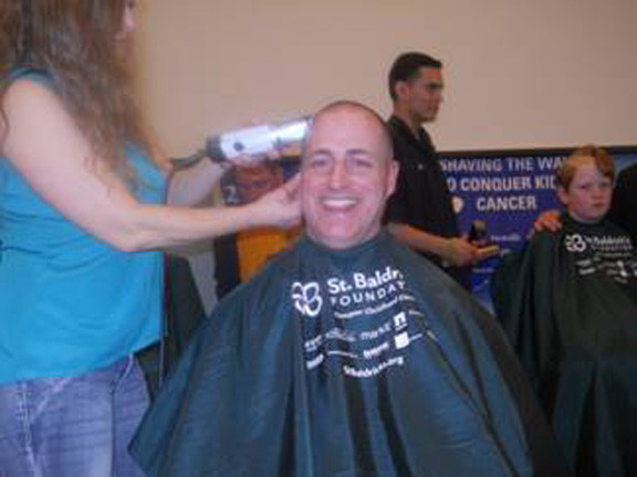 Assemblyman Brian Curran gets head shaved as part of the St. Baldrick's fundraiser.