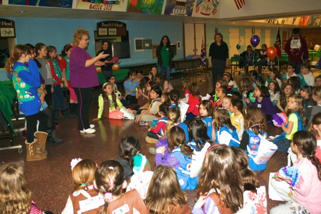 "Junior Troop #2417 lead Dasies and Brownies from Oceanside and Island park  around the ""camp fire"" to sing girl scout songs durring the GS World thinking day event."