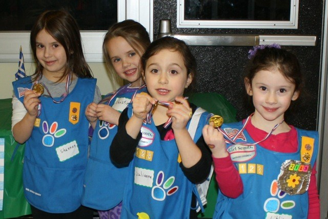 Shannon Monahan, 5, Christie Larkin, 6, Julianna Ewashko,5, and Libby Meltzer, 5, won their gold metals durring the olympic games at the Greek table!
