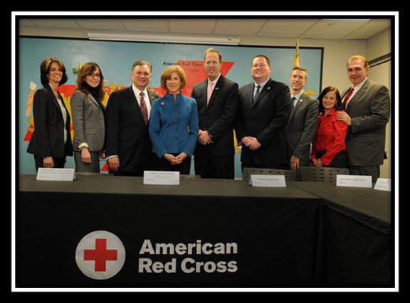 Randi Shubin- Dresner, President of Island Harvest (left); Gwen O'Shea, Health and Welfare Counsel of Long Island; County Executive Mangano; Gail J. McGovern, President and CEO of the American Red Cross; Kevin Law, Long Island Association; John Miller, CEO of the Long Island Red Cross; Josh Lockwood, CEO of the Greater New York Region of the Red Cross; and Jeanne and Tom Gargiulo, Babylon Village residents who lost their home in Hurricane Sandy and who have become Red Cross volunteers.