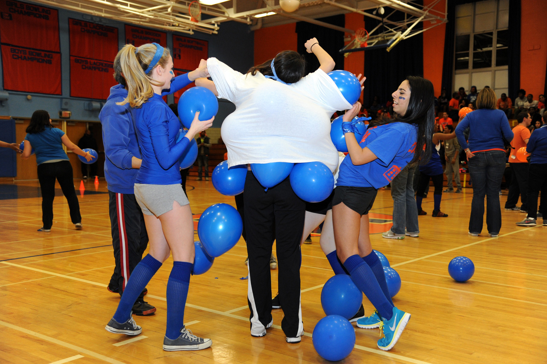 "The Blue team  shows off its picture of assistant principal Romano (above). Left, the Blue team takes part in the ""pump 'em up race."""