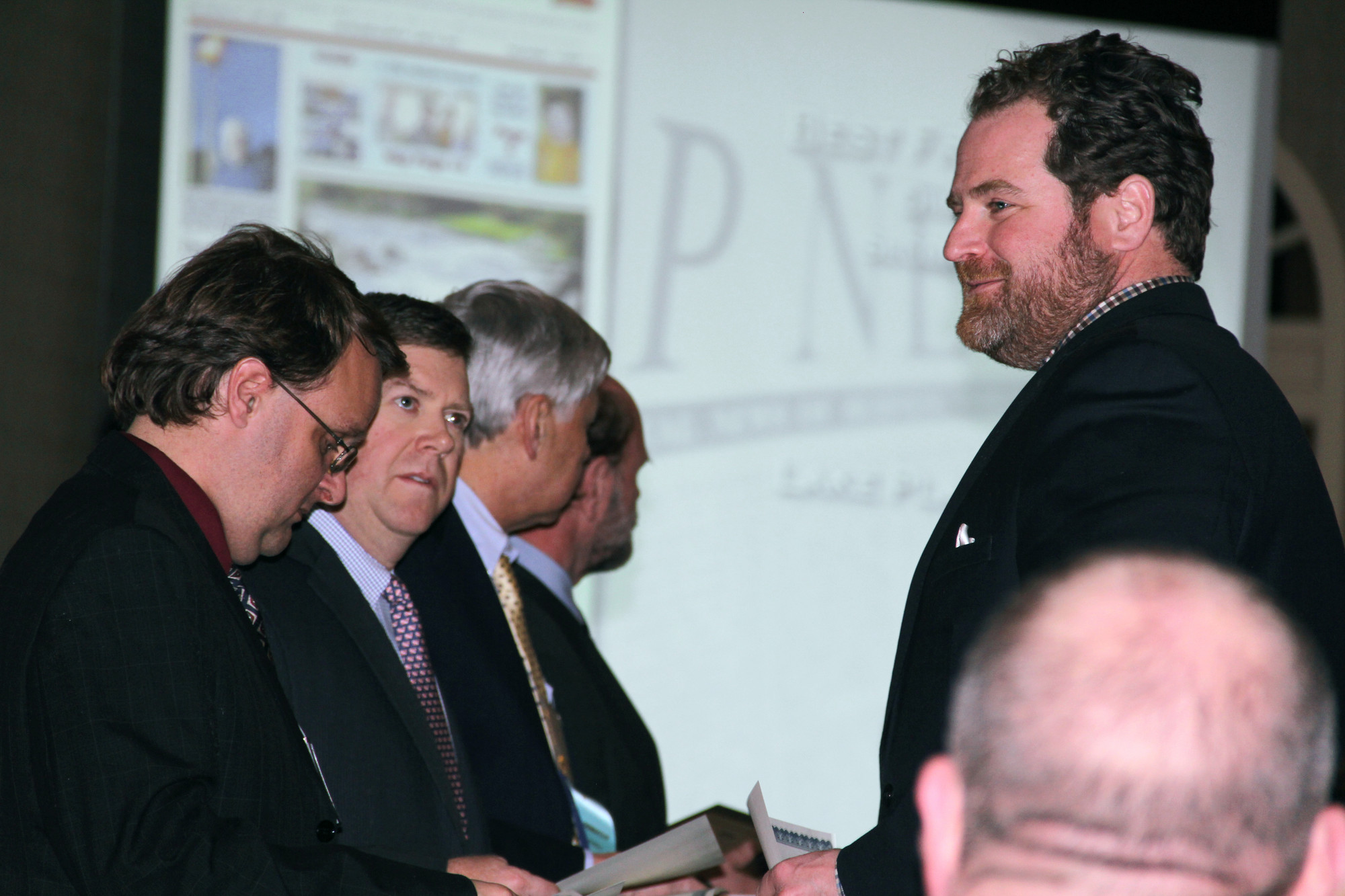 Baldwin Editor Chris Connolly receives an award for Best Front Page.