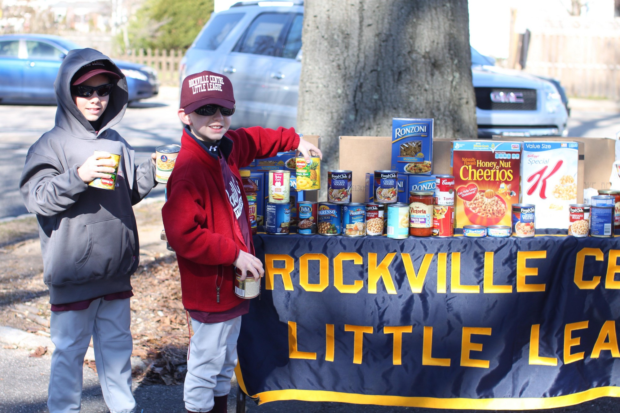 Justin and Davis Luckner, 10, dropped off cans of food for the RVC Little League food drive, which collected about 2,000 pounds of food.