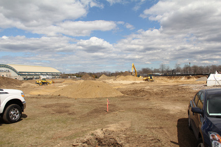Dirt mounds are a frequent sight at Eisenhower Park, as construction on the Twin Rinks Ice Center continues. County officials hope to have the outdoor rink completed this year.
