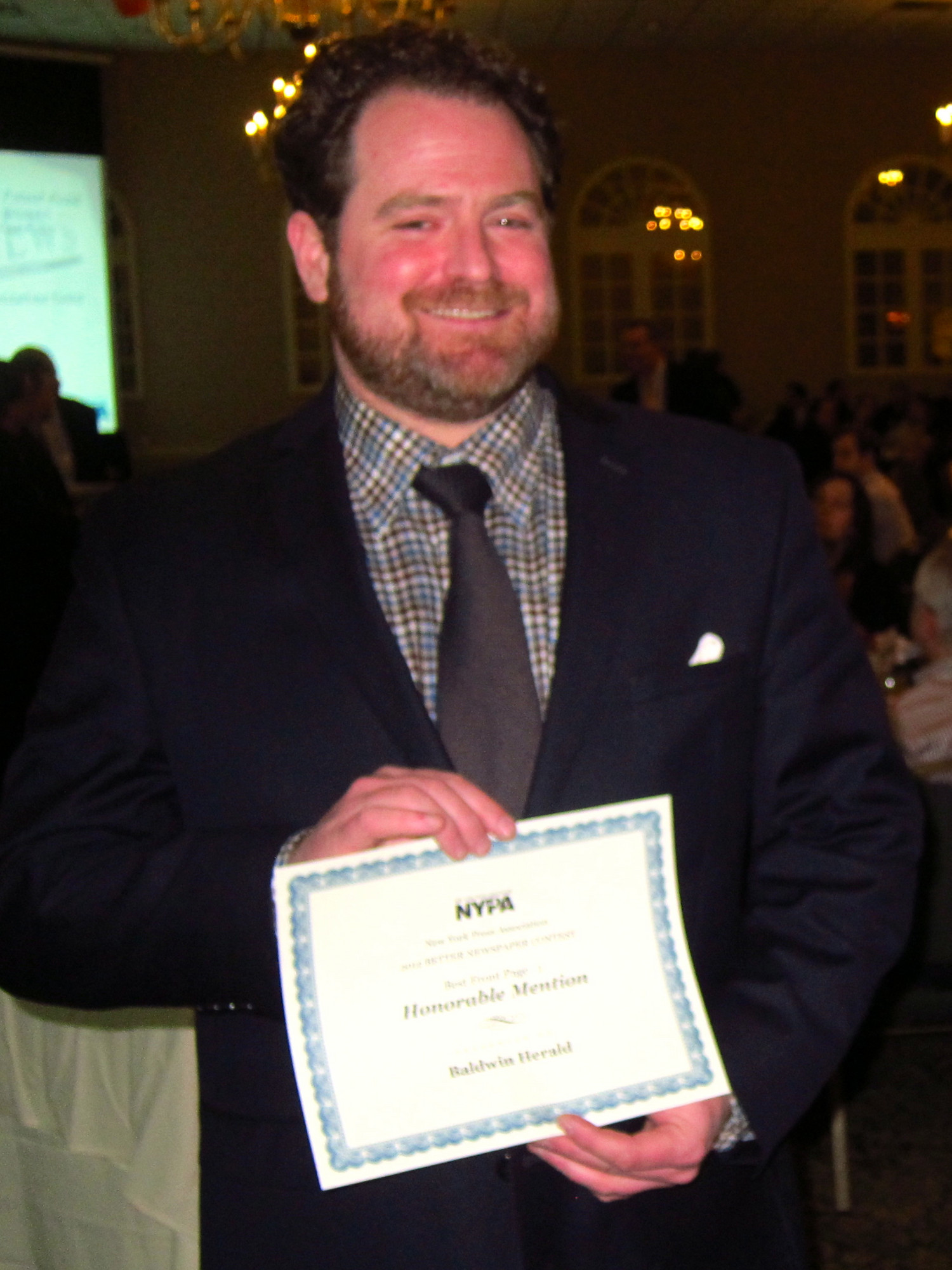 Chris Connolly, editor of the Baldwin Herald, was one of many Herald editors, reporters, photographers and design staffers who won awards at the New York Press Association Better Newspaper Contest.