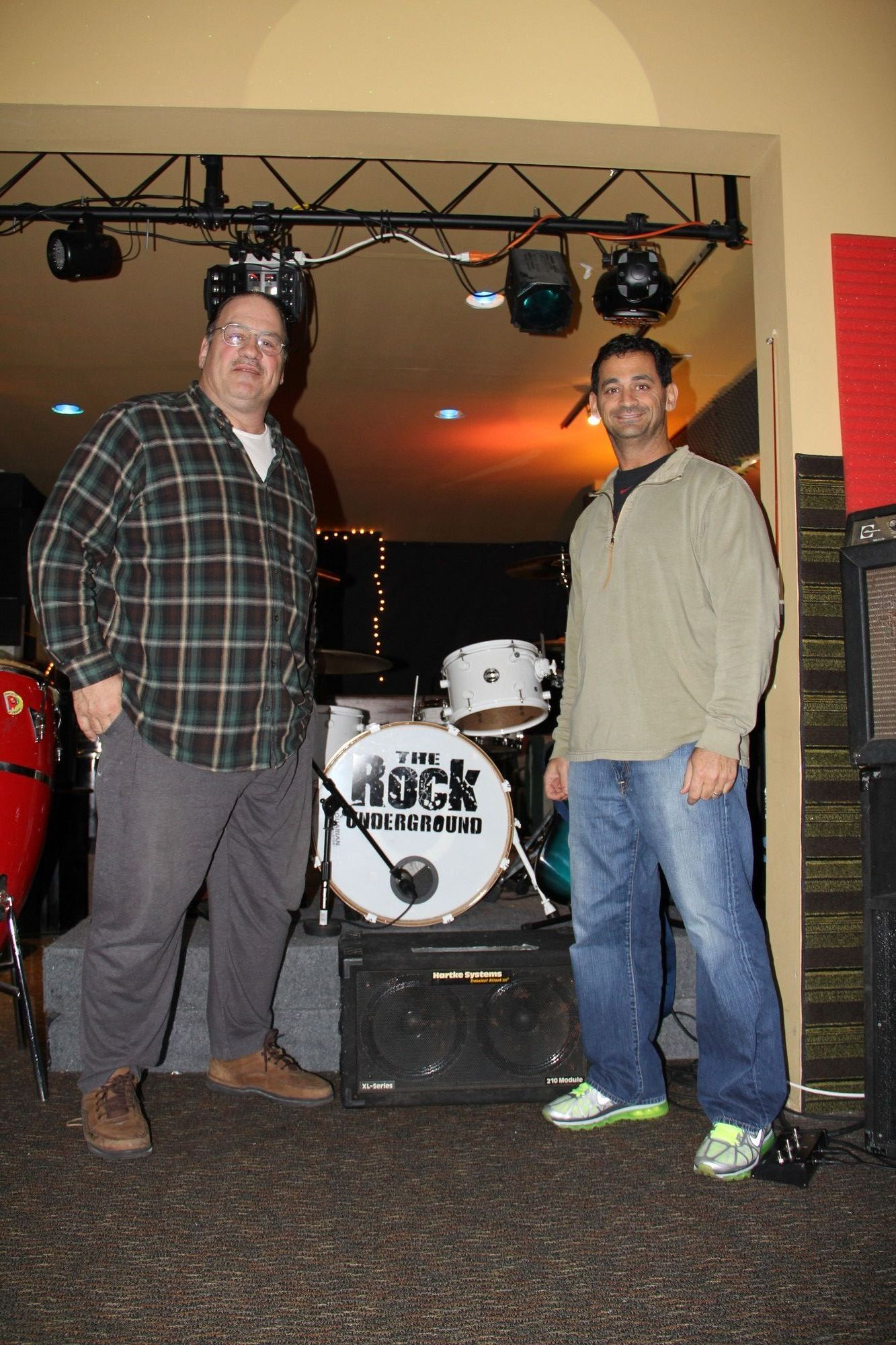 Emilio Manzo, president of the Community Wellness Council, left, reached out to Steve Eplan, co-owner of The Rock Underground, to help organize the first battle of the bands.