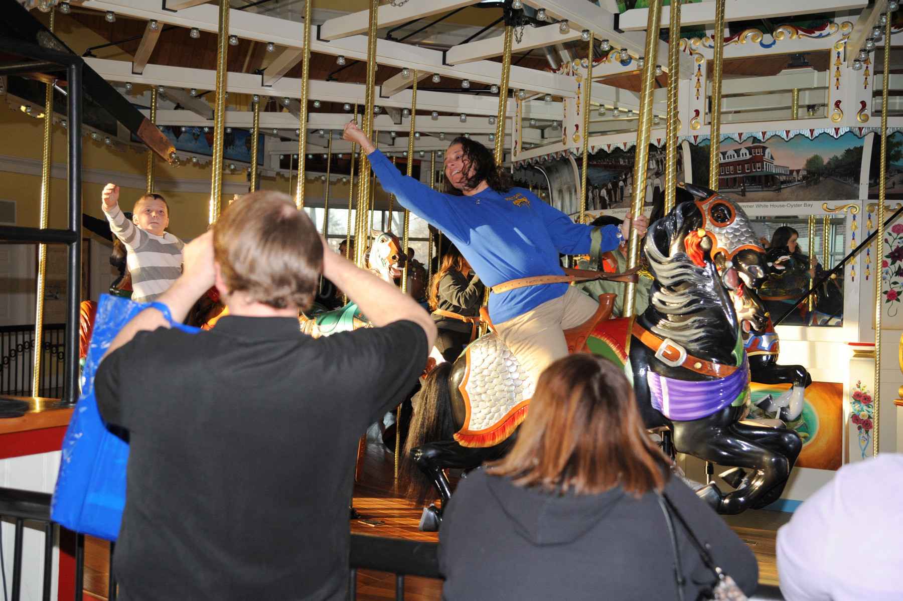 Nancy Radecker reached for (and got) the ring on Nunley�s famous carousel.