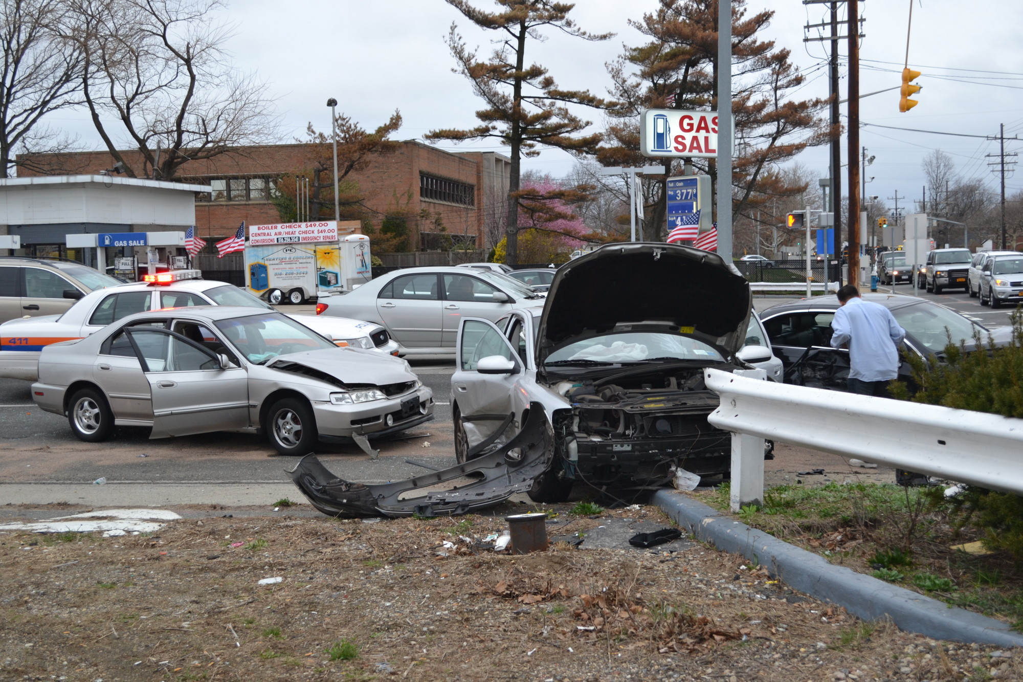 Three people were injured in a three-car accident at the intersection of Peninsula Boulevard and Mill Road in Hewlett.