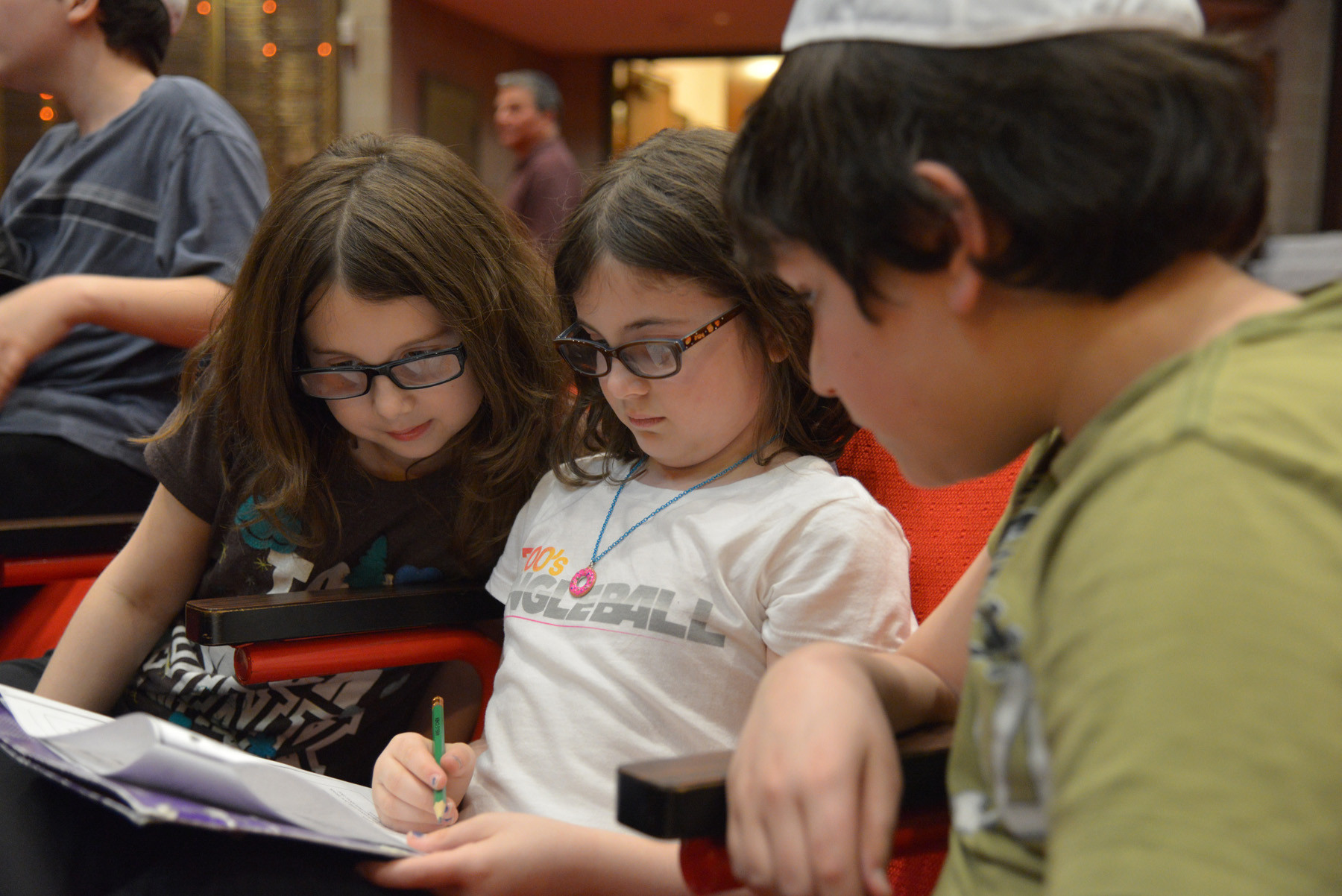 Alexa, 8, and Arielle Cohen, 10,  and Aaron Knigin studied in the santuary before the 