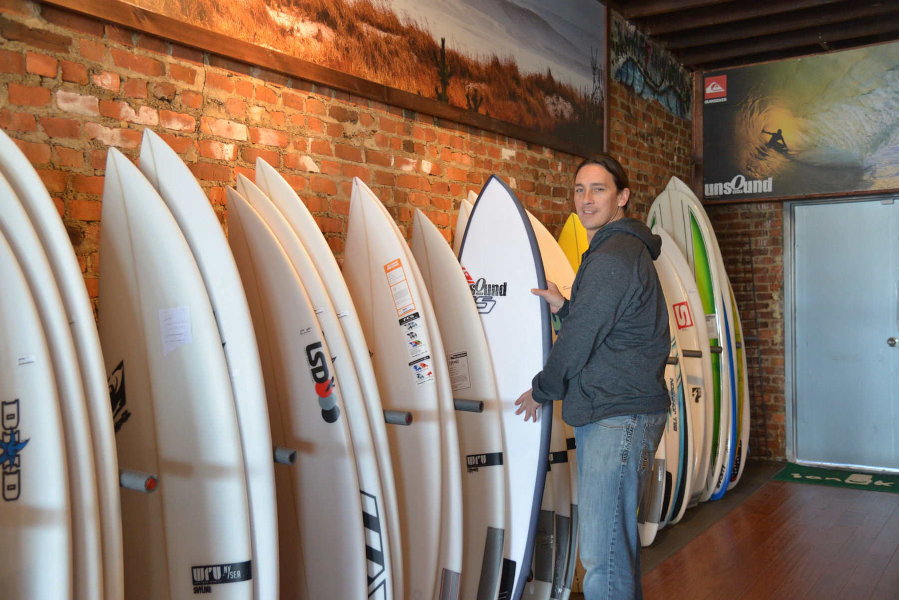 Dave Juan inside the new store, which is stocked with new surfboards, gear and other inventory.