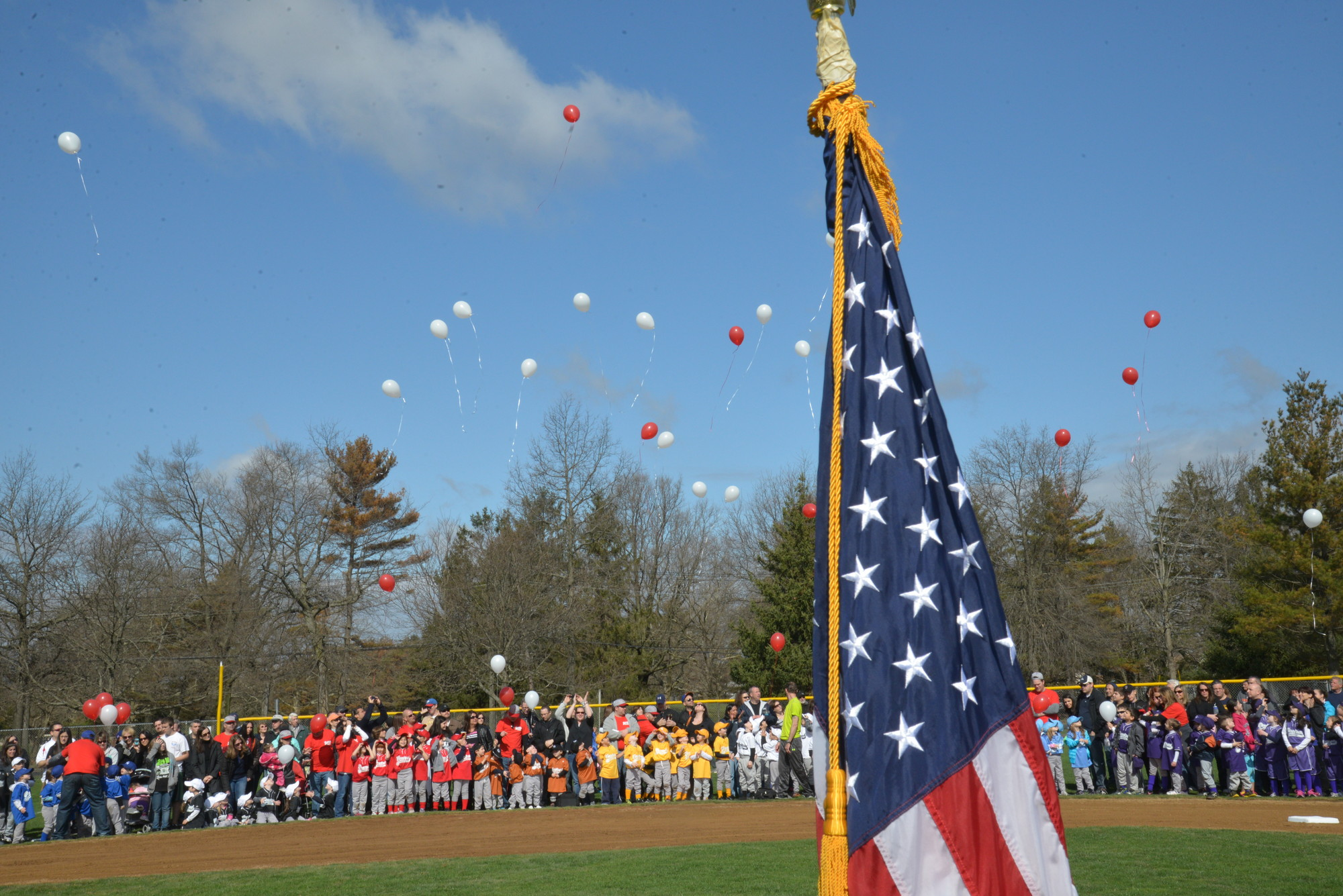 During its annual parade last Saturday, members of the Central Nassau Little League Association released balloons to commemorate Harlie Treanor, a former Little Leaguer who died last July. Story, more photos, page 3.