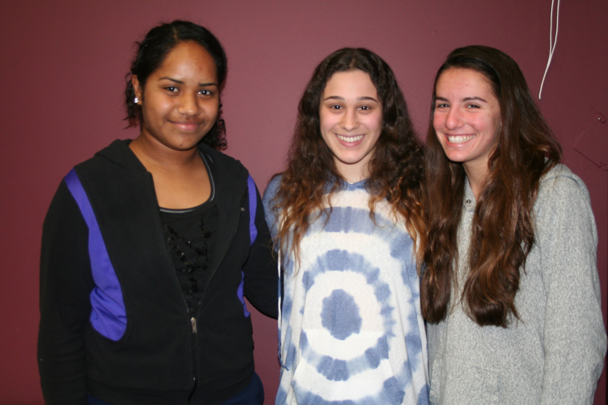 Hewlett High School students are involved in helping to revive the community's Memorial Day parade, slated for May 27. From left were, high school students Talei Tarakinikini, Jaime Kasner and Sydney Rosenblum.