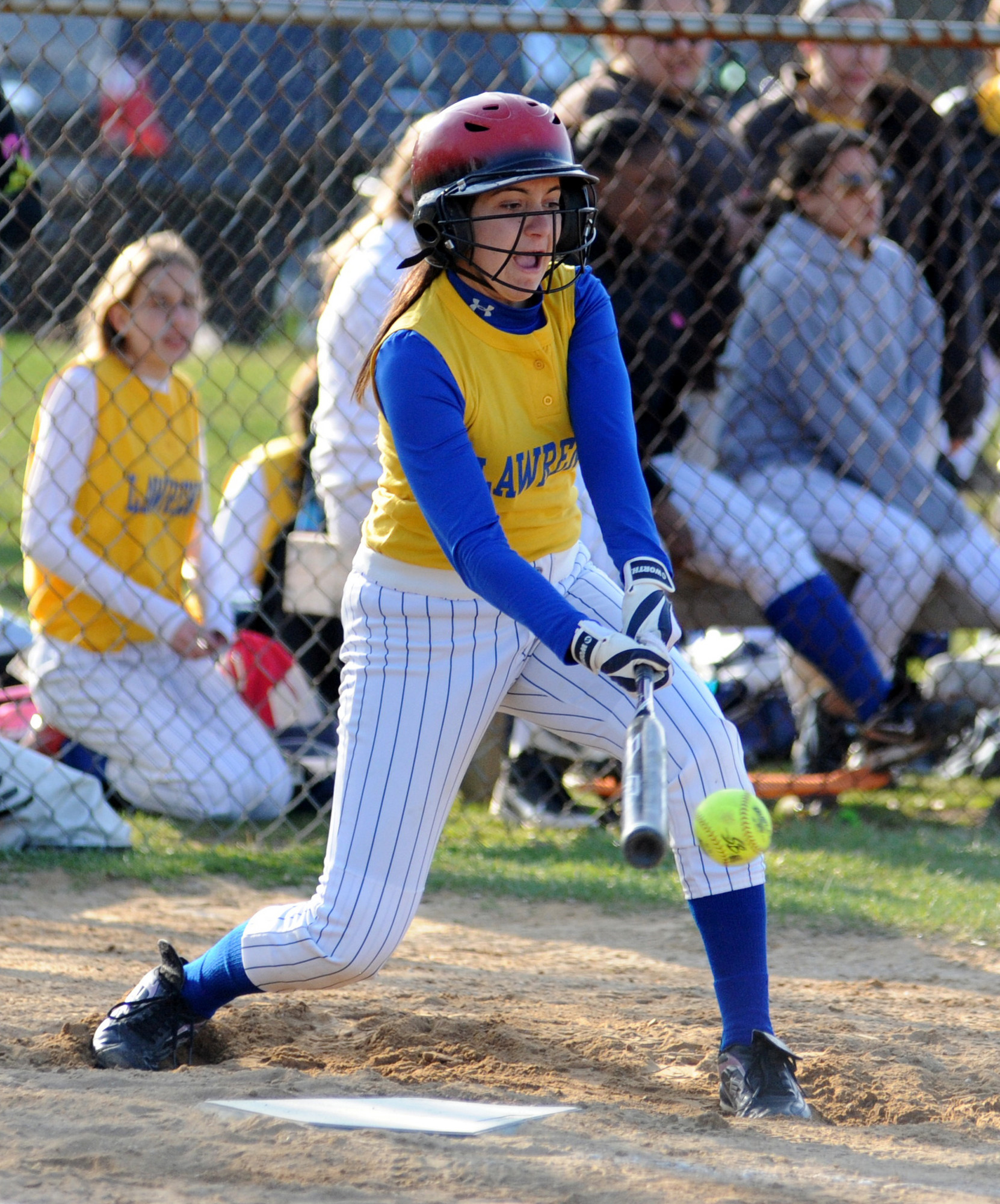 Lawrence's Daniella Bordanaro, one of six freshmen on the team, makes contact during last Monday�s loss to Lynbrook.