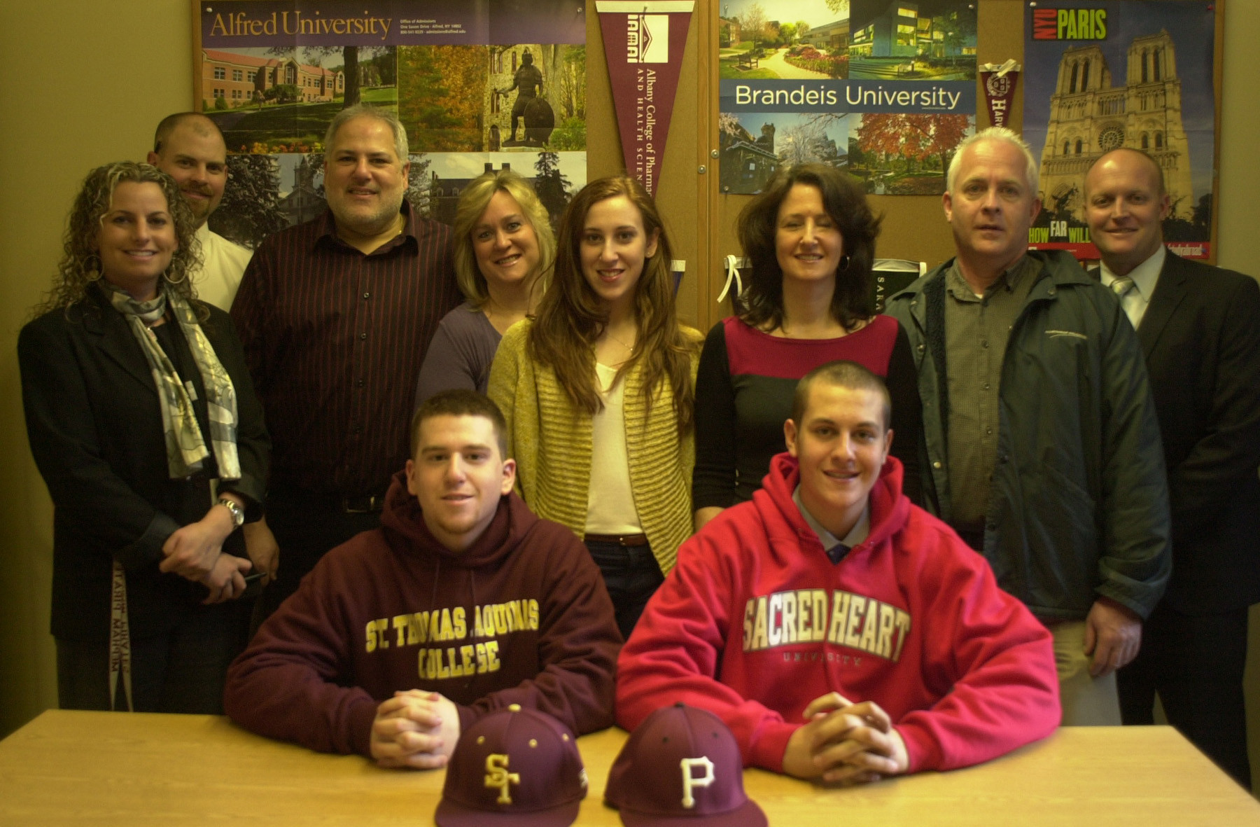 Mepham High School seniors Brian Helft, center left, and Jason Foley have been recruited to play baseball in college. They were joined here by their families and Mepham administrators.