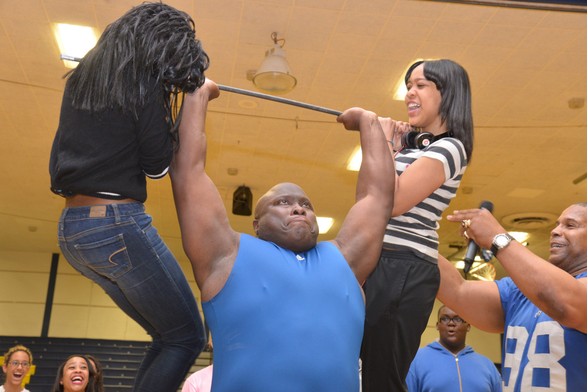 Clarence Lee, from Florida State University, lifted Nedyah Alexis and Kezia Bent as part of a motivational program at BHS.