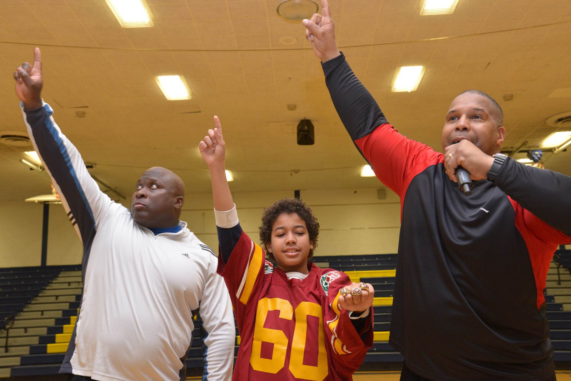 Clarence Lee, left, Ayden Steward and Keith Davis, a former New York Giant, at BHS during the Winners Inc. presentation. Ayden was wearing a number of the football players' championship rings at the closing of the 